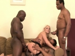 Aroused blonde gets a couple of black penises