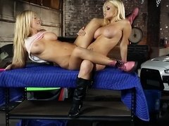 A blonde with large tits is with her also busty friend, fucking her