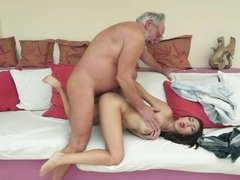 A brunette that enjoys attention is getting fucked by an old dude