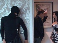 A curvy slut is getting fucked in the bedroom by a burglar