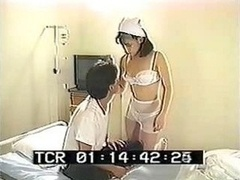 Busty Japanese nurse lets this patient check out her hairy pink slit