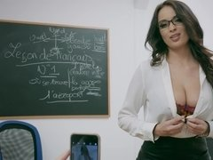 A woman with glasses is doing a blow job in the classroom to her lover