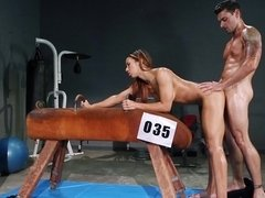 A brunette that has a sexy black ass is fucked in the gym deeply