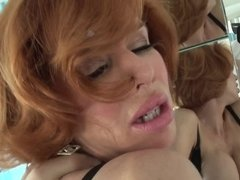 A redhead that enjoys anal sex is getting penetrated deeply