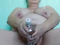 Sexually available mom Margarita masturbates with bottle
