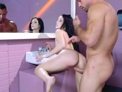 A busty raven haired bitch is getting fucked in the bathroom