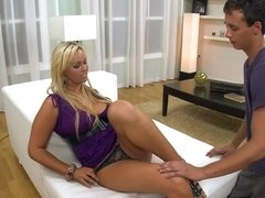 Blonde with large nipples is spreading her long shapely legs