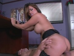 A camera focuses on a hot babe with large boobs and ass