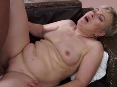 A granny that loves cock is placing her mouth on a large and big one