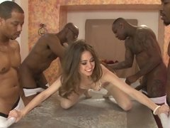 A petite thing is fucked by several black men in a gangbang