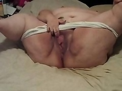 Huge chubby granny is rubbing her hairless honey pot hard to get off