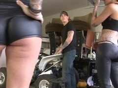 Two girls are getting fucked by a dude by his motorbike