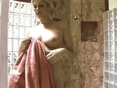Beautiful blonde having sex after shower