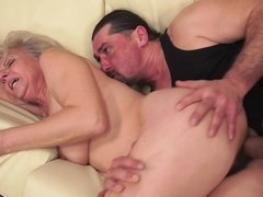 A fat granny is receiving a young cock in her hairy old pussy