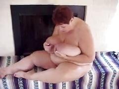 Big beautiful women moves her milk sacks