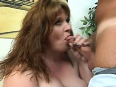 Obese broad is performing great blow job to her dark boyfriend