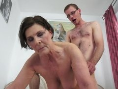 A fat old hairy woman gets her cunt penetrated as she bends over