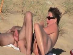 Non-pro couple having an intercourse on the beach