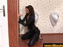 Tall brunette sucking cock at the gloryhole