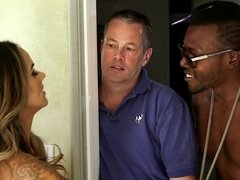 A hot brunette receives a large black dick while her husband watches her