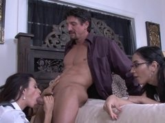 A mom and daughter are in the bed and they are getting fucked hard