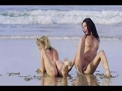 Naked Girl playing on a beach