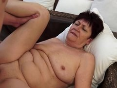A fat granny with a shaved pussy is getting a dick in her wet cunt