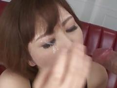 Tomoka Sakurai appears to be giving blowjob on two purple poles