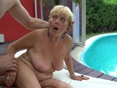 Nasty old blonde that loves cock is getting fucked by the pool