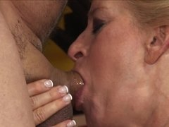 Blonde granny with a big ass is getting her pussy penetrated by her partner