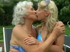 Granny kissing, licking & making love young-looking blonde