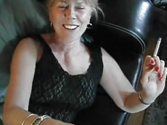 smoking mom getting down and dirty black cock at home