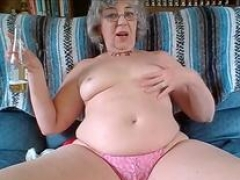 Hot Granny with Short Curly Hair and besides Glasses has Young-looking Pink slit