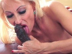 Blonde puts her mouth around a cock and she sucks it like a pro