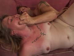 A horny granny is getting penetrated in her tattooed cunt