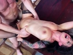 A tattooed slut gets her pussy penetrated in the office on desk