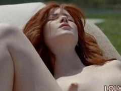 Charming redhaired girl rubbing