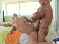 Horny gays Robert Axel and Brant Dickson bang doggy style after massage
