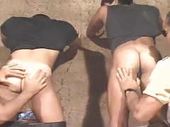 Two policemen rimming two studs