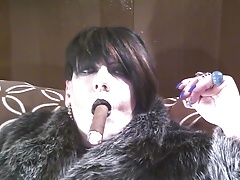Fur and a cigar.