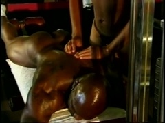Muscular black dude drills his BF's ass in the gym