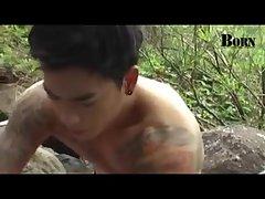 Tattoed Asian guy outdoor
