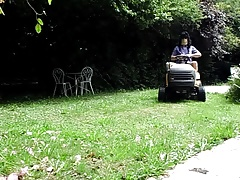 Striptease on lawn tractor - anal insertion of the lever