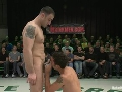 Tattooed stud fucks a twink on tatami after beating him