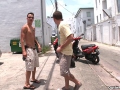 Two handsome gays Tyler Ford and Travis Cooper make love in a park