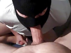 Masked cocksucker works a verbal guy's dick good with facial