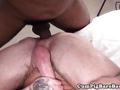 Muscular black dude barebacking inked hunk