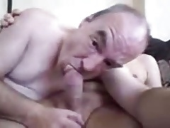 Older man playing with the other grandpa dick