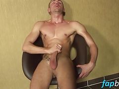 Blonde stud with tattoos masturbates