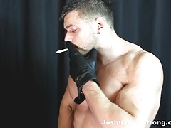Smoking and wanking with his sexy leather gloves